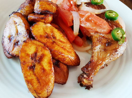 fried plantain with grilled chicken leg quarter