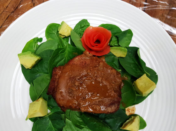 steak on a bed of spinach
